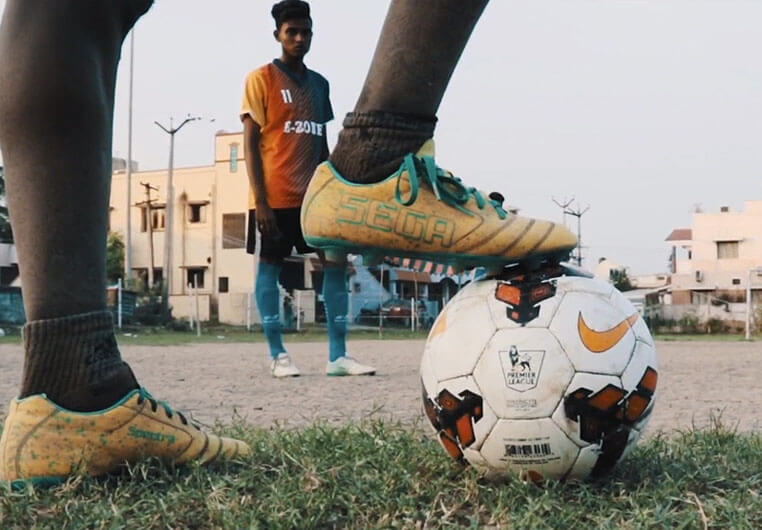 Indian teenagers playing soccer.