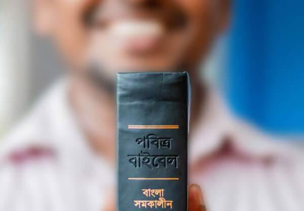 Man holding new Bible translation