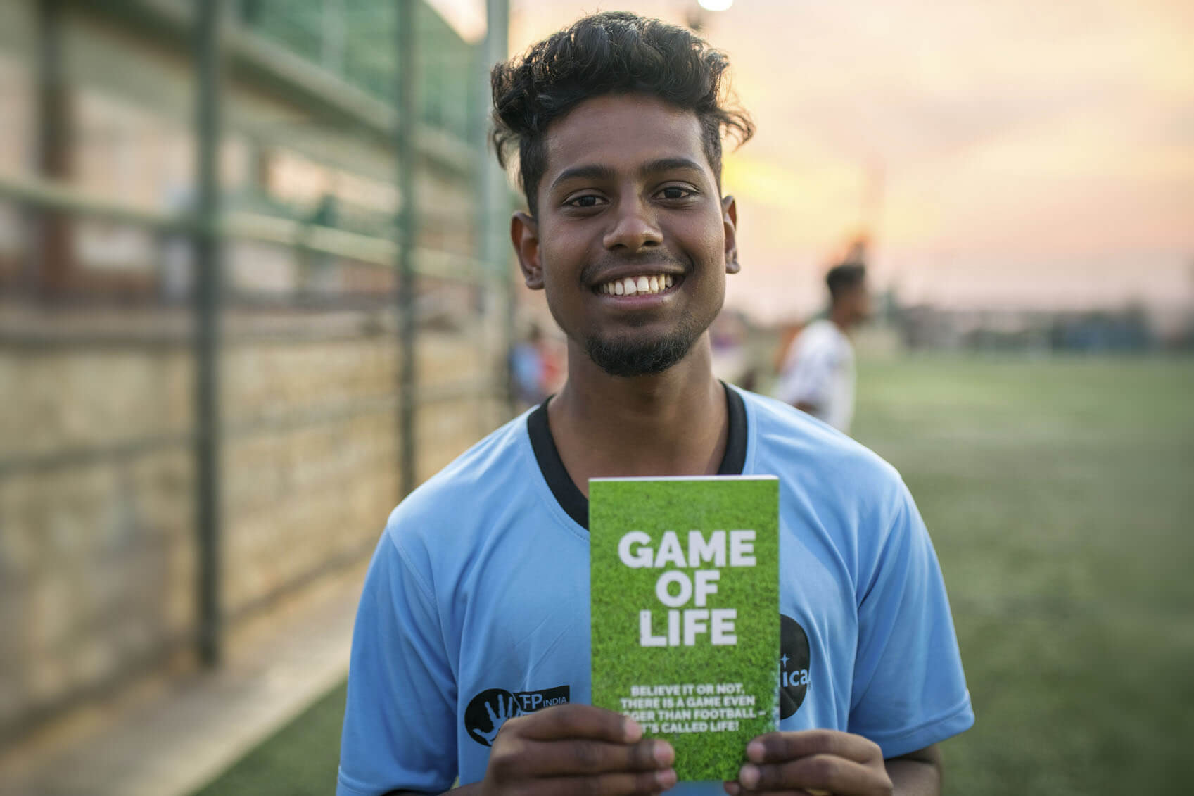Teenage Boy Holding Game of Life Book