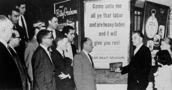 Billy Graham finds both a text and congregation underground. Location: Uptown Lexington Avenue Subway at 51st Street.