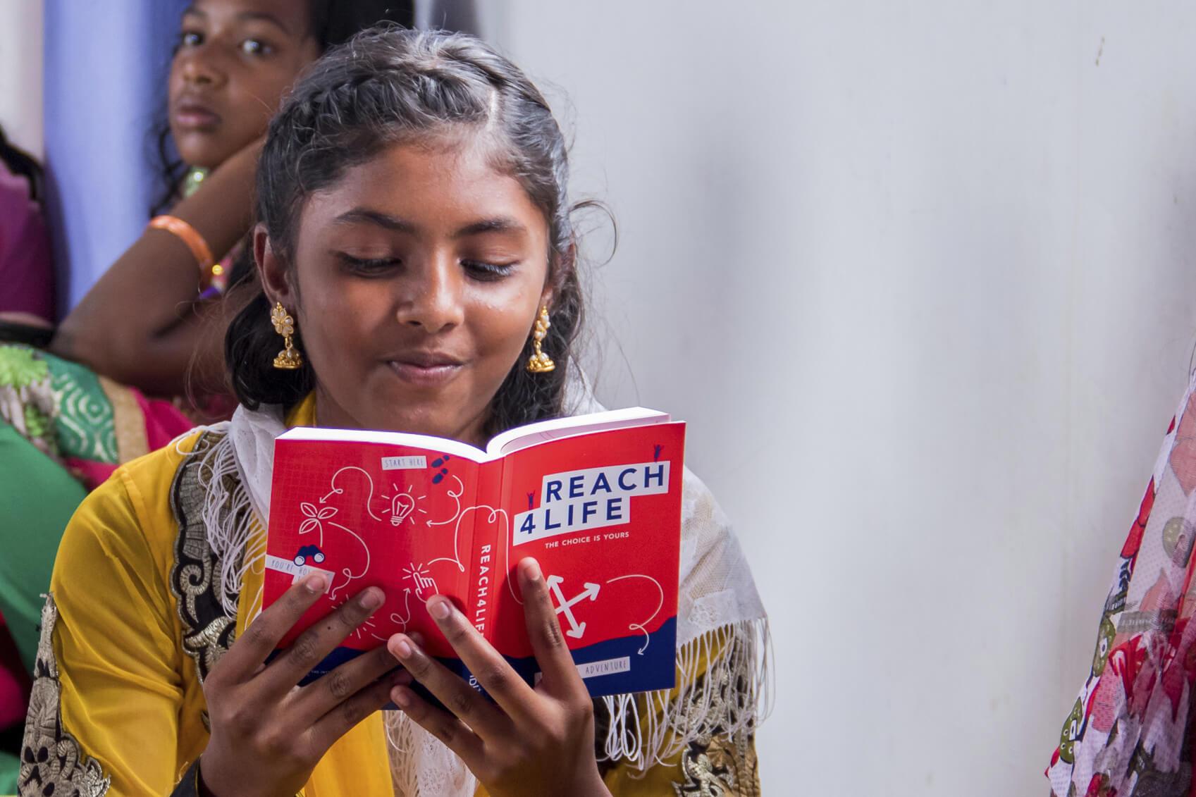 Girl Reading Reach4Life