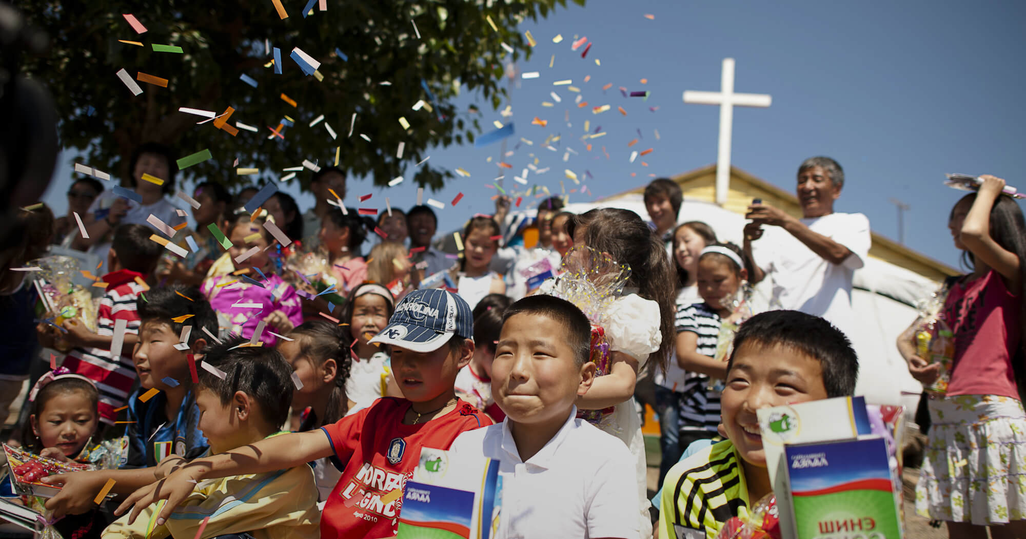 Children celebrating with Bibles