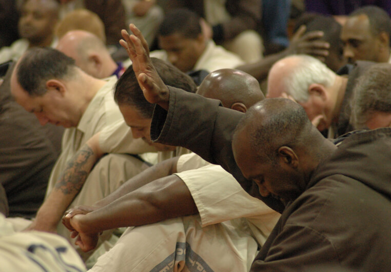 Prisoners worshiping during a prison church service